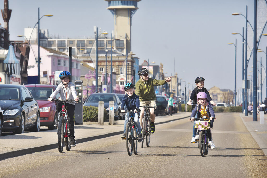 Decorative - Family on bicycles on seafront